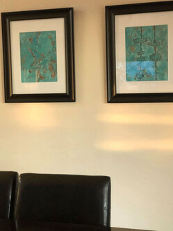 Picture of Modern Abstract paintings on wall above dining room table